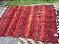 A mixed red rug