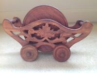 SIX WOODEN COASTERS AND CARRIAGE HOLDER