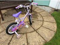 "Girls Bike Purple. Apollo petal. 14"" wheels."