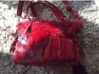 Stylish unused handbag.