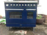 Britainia free standing cooker stainless steel and blue.