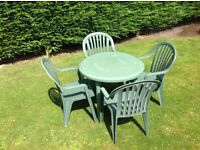 Green plastic garden table and 4 x chairs