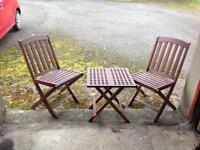 Folding picnic table and chairs.