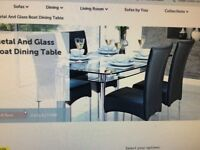 As new (excellent condition)Black glass/chrome Boat Dining table and 6 chairs