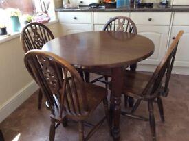 Dark wood round table & 4 chairs.