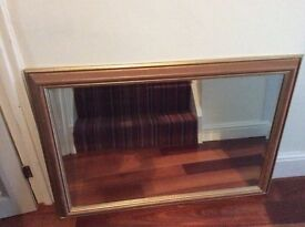 A lovely bevelled edge mirror finished in rose gold colour