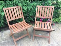 Pair wooden folding garden chairs