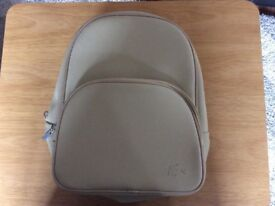 Woman's Lacoste back pack style hand bag