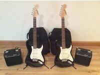 2 Black white, star caster, electric guitar, amp and carry case.