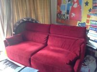 Beautiful and comfortable red velvet sofa
