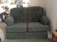 Green 2 seater sofa with matching arm chair good condition, good for a small space