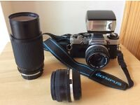 OLYMPUS OM 10 35mm SLR with 50mm lens and strap. Plus 80-200mm zoom lens, flash 28mm wide angle lens