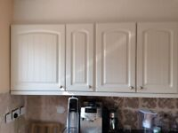 White kitchen wall and oven units mixed sizes