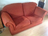 Two seater sofa.... terracotta colour..... meets fire safety