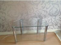 TV stand with 3 clear glass shelves and chrome legs