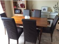 A modern wooden 6 seater dinning room table @ chairs.