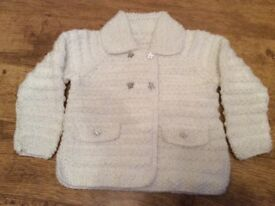 Hand knitted child's jacket