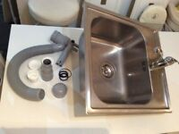 Stainless steel sink, tap, strainer and water trap