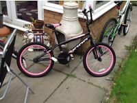 Black and pink child bmx bike