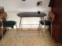 Glass breakfast table and 2 chairs