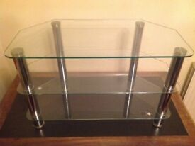 Glass and silver coloured TV stand