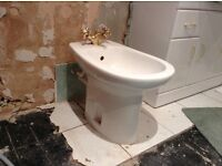 "White porcelain bidet comelete with ""gold""capstan head mixer taps, waste and plug"