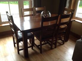 Oak dining room table and 6 chairs.