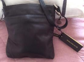 Brand new with TAGS still on .BLACK leather Bag