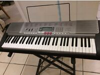 Casio LK-230 keyboard and Tiger stand. Great keyboard for beginners