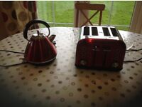 Shiny red 4 slice toaster and mAtching kettle