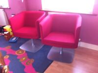 Pair of red tub chairs