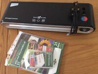 Laminator and new laminating pouches