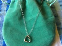ladies silver coloured necklace