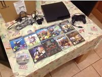 Playstation 3 Slim Console with 9 games