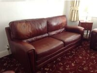 Chestnut leather three piece suite.