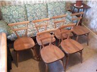 Six Ercol Green Dot Stacking Chairs