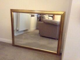 Large gold effect frame bevelled mirror.