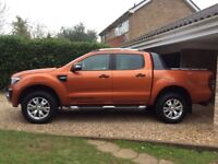 Ford ranger wildtrack for sale in orange with mountain rollover cover 3.2. 6 speed manual