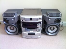 Mini hifi component system. Tape/CD/radio player with speakers. Good condition.