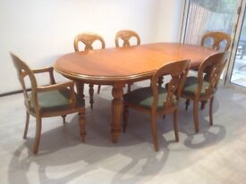 Extendable teak traditional dining set, in good condition, 4 chairs and 2 carvers, now reduced!