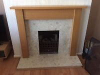 Marble and wood fire surround.