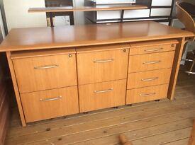 Wood desk with locking draws.