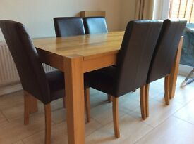 solid wooden dinning table and 6 leather chairs