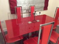 Red dining table and six chairs