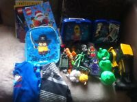 Bundle of boys toys and clothes coats and snowboots