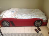 Child's red sports car single bed