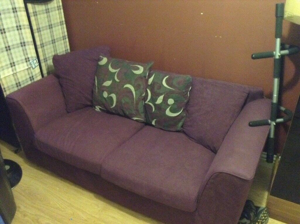 Used purple sofa and coffee table in perfect condition