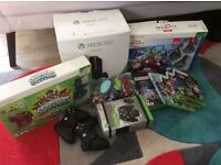 XBox 360 (boxed) with 8 games and accessories -excellent condition