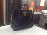 Michael Kors handbag navy in colour. Used but in great condition.