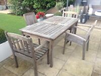 Solid teak garden patio table and 4 chairs with armrests £75 Ono tel 07966921804